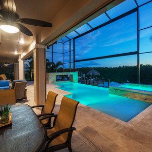 Foto de piscinas y jacuzzis infinitos, modernos, de tamaño medio, interiores y a medida, con suelo de baldosas