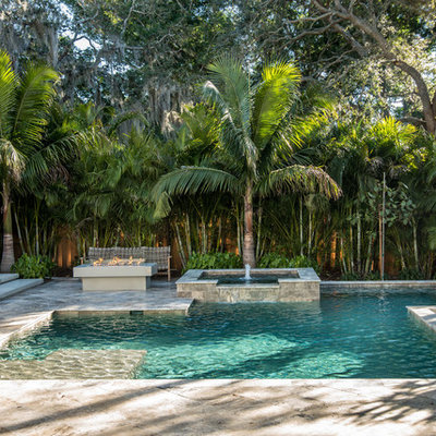 Inspiration for a contemporary backyard tile and custom-shaped pool fountain remodel in Tampa