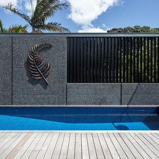 Idee per una piscina fuori terra industriale rettangolare di medie dimensioni e sul tetto con pedane