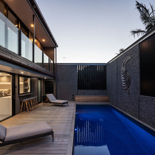 Esempio di un'ampia piscina fuori terra industriale rettangolare sul tetto con pedane
