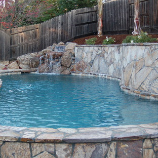 Example of a small mountain style backyard stone and custom-shaped pool fountain design in Sacramento