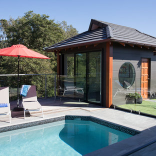 Photo of a mid-sized asian backyard rectangular lap pool in Brisbane with a pool house.