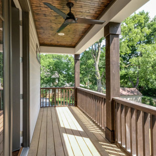 Inspiration for a mid-sized craftsman back porch remodel in Nashville with decking and a roof extension