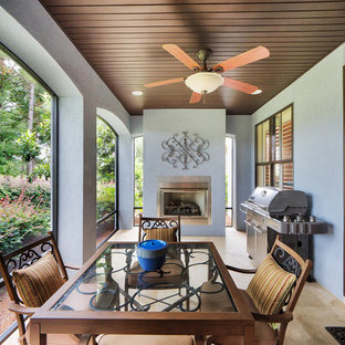 Inspiration for a timeless porch remodel in Miami with a fire pit