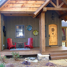 Rustic Porch by Higgins Building Group, Inc.