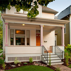 Traditional Porch by Building Arts Sustainable Architecture