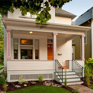 This is an example of a victorian front porch design in Minneapolis.