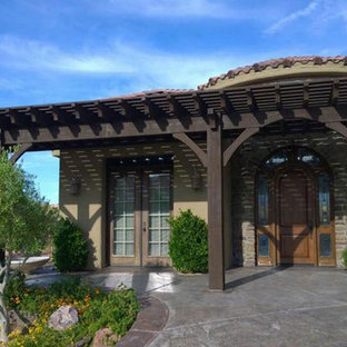 Inspiration for a mid-sized mediterranean concrete front porch remodel in Salt Lake City with a pergola