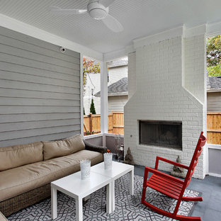 Transitional porch idea in Chicago with a fire pit and a roof extension