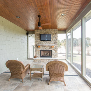 Mid-sized transitional tile screened-in side porch idea in Milwaukee with a roof extension