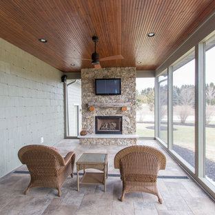 Inspiration for a mid-sized transitional tile screened-in side porch remodel in Milwaukee with a roof extension