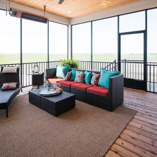 Mid-sized farmhouse screened-in back porch photo in Other with decking and a roof extension