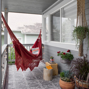 Inspiration for a small eclectic porch remodel in Denver