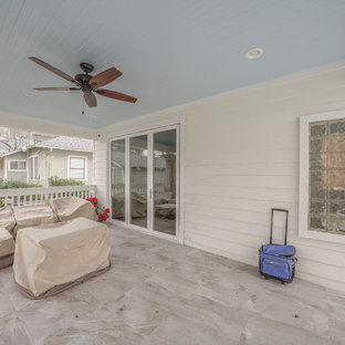 This is an example of a shabby-chic style porch design in Houston.