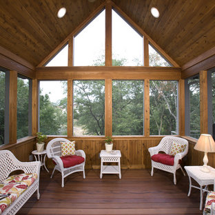Mountain style porch idea in Minneapolis with decking and a roof extension
