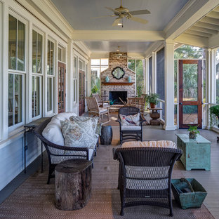 Classic screened-in porch idea in Atlanta with decking and a roof extension