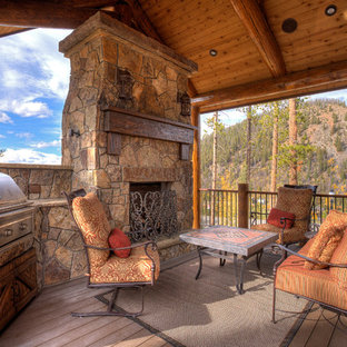 This is an example of a rustic porch design in Denver with decking.