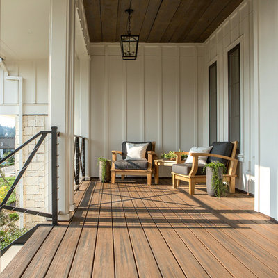 This is an example of a large cottage front porch design in Portland with decking and a roof extension.