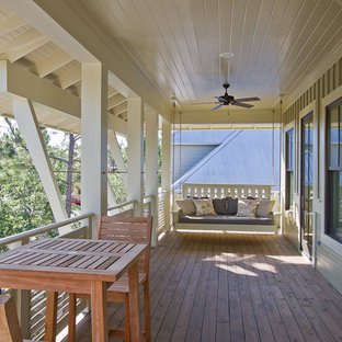 This is an example of a beach style porch design in Miami.