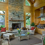 Covered Porch With Stone Hearth Fireplace And Attached