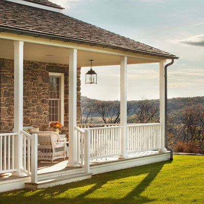 Farmhouse back porch idea in New York with decking and a roof extension