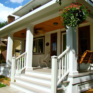 Inspiration for a mid-sized timeless front porch remodel in Minneapolis with decking and a roof extension