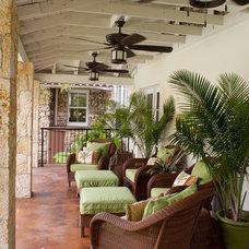 Tropical Porch by Sebastian Eilert Architecture, Inc