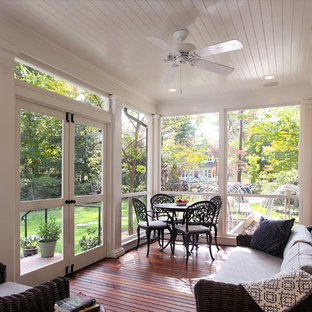Mid-sized arts and crafts screened-in side porch photo in DC Metro with decking and a roof extension