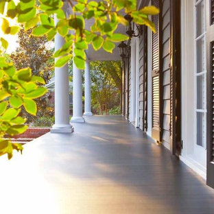Inspiration for a mid-sized craftsman front porch remodel in Boston with decking