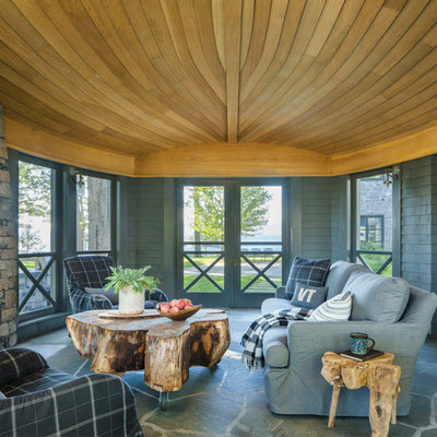 Inspiration for a country back porch remodel in Burlington with a roof extension