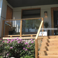Traditional Porch by Express Glass and Railing Systems