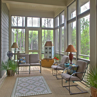 Eclectic screened-in porch photo in Miami with decking and a roof extension