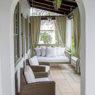 Tuscan porch idea in Miami with a roof extension