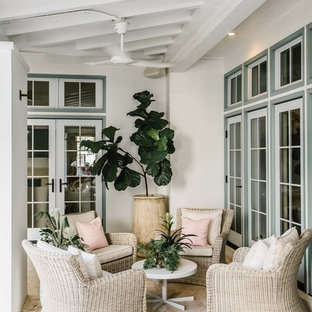 Inspiration for a coastal porch container garden remodel in Miami with a roof extension