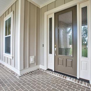 Diseño de terraza clásica renovada, de tamaño medio, en patio delantero y anexo de casas, con adoquines de ladrillo