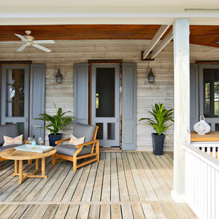 This is an example of a coastal porch design in San Francisco with decking and a roof extension.