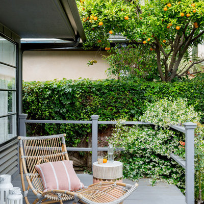 Trendy back porch idea in Los Angeles with decking and a roof extension