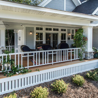 Mid-sized arts and crafts front porch photo in Minneapolis with decking and a roof extension