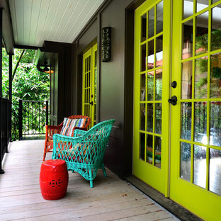 Inspiration for an eclectic porch remodel in Houston with decking