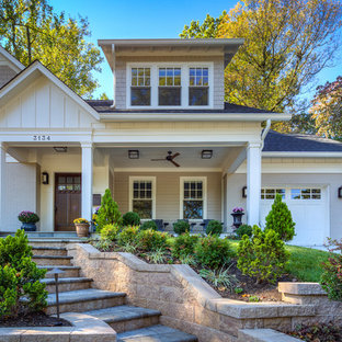 Inspiration for a small craftsman concrete paver screened-in front porch remodel in DC Metro with a roof extension