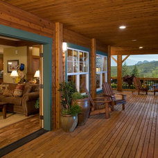 Traditional Porch by timberland homes inc.