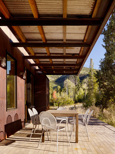 Farmhouse Porch by Carney Logan Burke Architects