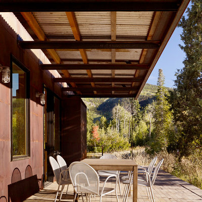 Farmhouse porch idea in Salt Lake City with decking and a roof extension