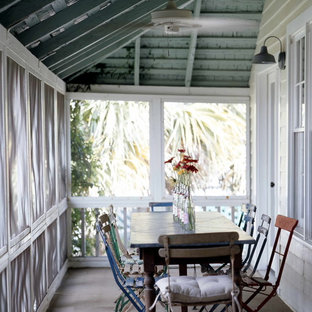 Cottage chic screened-in porch idea in Atlanta with a roof extension