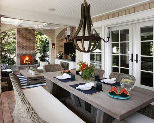 Coastal porch idea in Philadelphia with a fire pit, decking and a roof  extension - Patio Dining Table Houzz