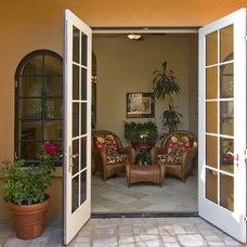 Mediterranean Porch by Cherie Myrick Interiors