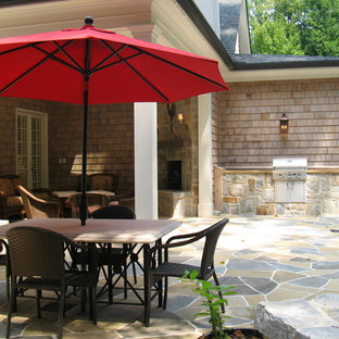 Mid-sized classic stone porch idea in Atlanta with a roof extension