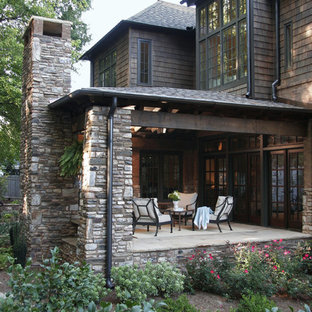 Elegant porch photo in Atlanta with a roof extension