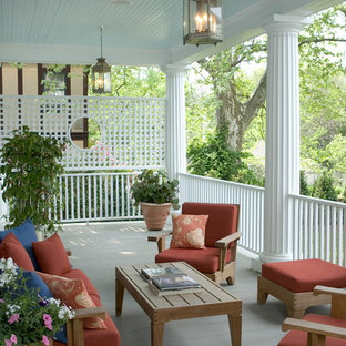 Inspiration for a large timeless back porch remodel in Other with decking and a roof extension