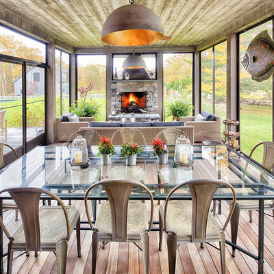 Large country screened-in porch idea in Burlington with decking and a roof extension